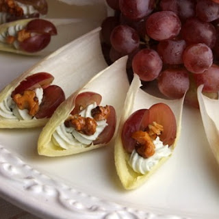 Endive with Blue Cheese, Grapes and Candied Walnuts.