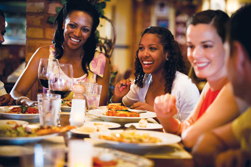 Norwegian-Cruise-Line-dining-LaCucina-group - Head to La Cucina, a casual Italian trattoria on your Norwegian Cruise Line ship, for meals with large portions, perfect for sharing with family or friends.