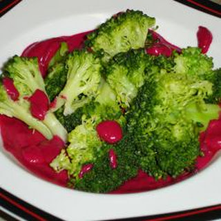 Steamed Broccoli Drizzled with Roasted Beet Sauce.