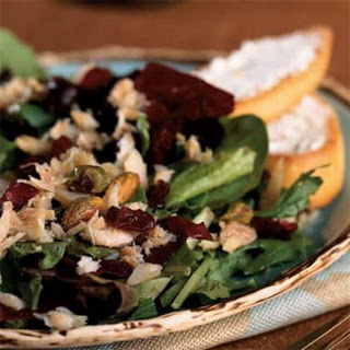 Mixed Greens Salad with Smoked Trout, Pistachios, and Cranberries.
