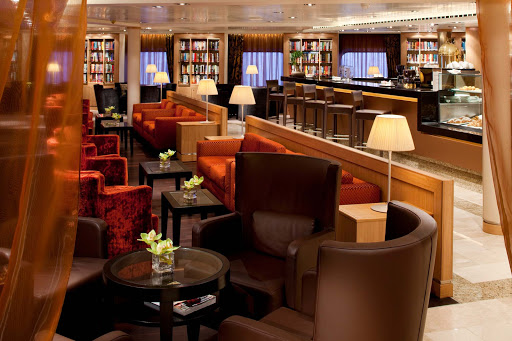 "Seabourn_Square - Seabourn Square replaces the traditional reception lobby with a more welcoming, ""living-room-style"" lounge. There you can recieve help from any of the Guest Services specialists, enjoy a good book on one of the  sofas and have a cup of specialty coffee."