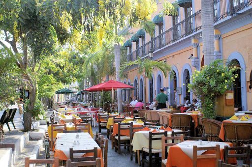 parque-Mazatlan-Mexico - A row of outdoor restaurants alongside a park in Mazatlan, Mexico.