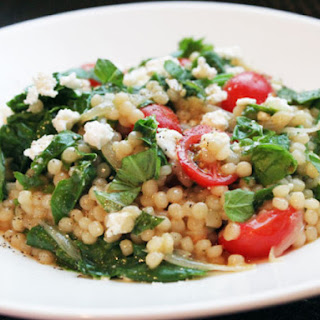 Skillet Pearled Couscous with Tomatoes, Feta, and Spinach.