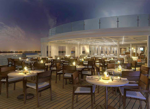 Viking-Longship-Aquavit-Terrace-at-dusk - At night the Aquavit Terrace aboard your Viking Longship transforms into a festive atmosphere perfect to enjoy a summer evening floating on Europe's waterways.