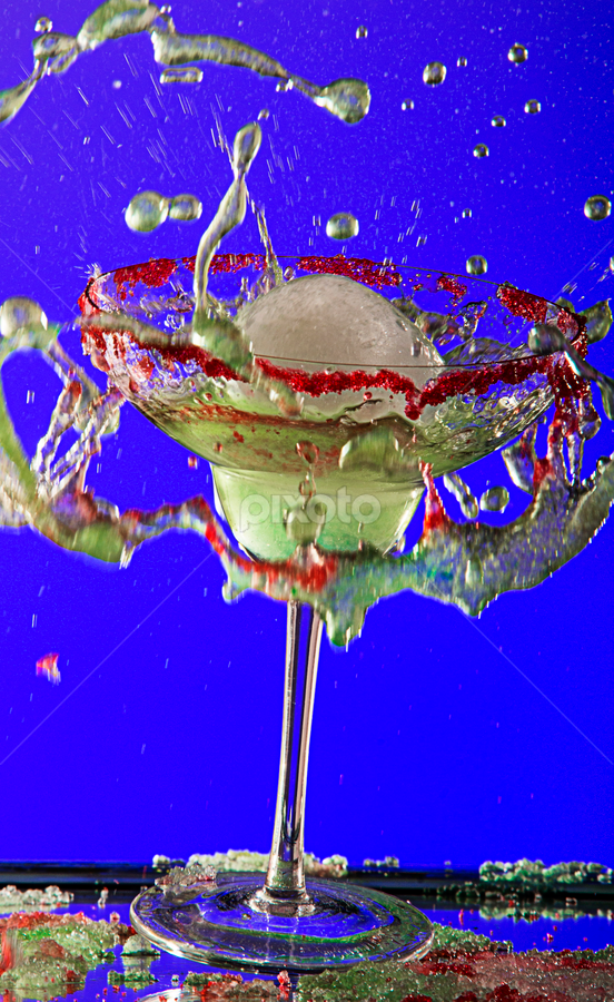 Margarita splash! by Amelia Falk - Food & Drink Alcohol & Drinks ( spectacular, stream, surface, splash, colorful, drop, shatter, yellow, glow, frozen, breakage, droplets, drink, glass, money, light, wine, water, spirits, fruit, trickle, green, bubbles, suspended, edible, amazing, color, blue, food, alcohol, explosion, slice, tension )