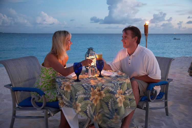A romantic dinner on the beach at dusk in Anguilla.