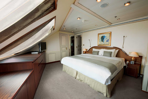 Silversea_Grand_Suite_3 - The Grand Suite aboard Silver Whisper has a spacious bedroom that features a queen size bed (or twin beds), sitting area and vanity table with hair dryer.