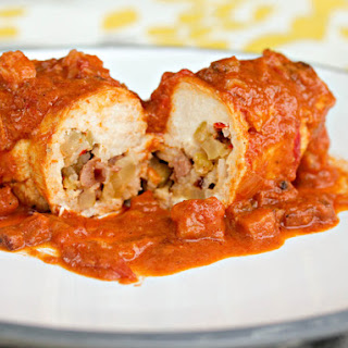 Andouille and Rice-Stuffed Chicken Breasts With Creamy Creole Shrimp Sauce.
