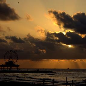 Sunrise @Galvestone Pleasure Pier by Sraddheshnu Basu - City,  Street & Park  City Parks ( clouds, silhouette, sea, sunrise, city park )