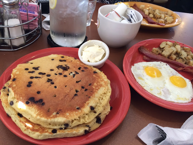 Chocolate Chip GF Pancakes, Eggs, Bacon and Peasant Potatoes. This meal was huge. The pancakes are a
