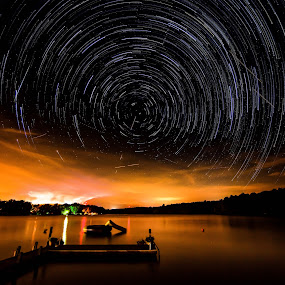Star trails over lightning storm at sunset by Luke Popwell - Landscapes Starscapes ( water, lightning storm, sunset, reflections, lake, meteor shower, night, star trails, docks, layered photo )
