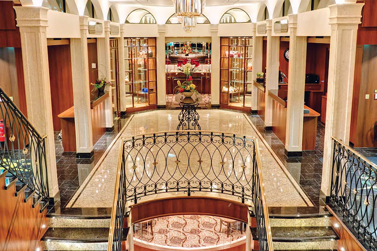 The elegant reception area aboard Tauck's new river cruise ships Inspire and Savor. At 443 feet, the ships are the maximum length for navigating the locks along Europe's waterways.