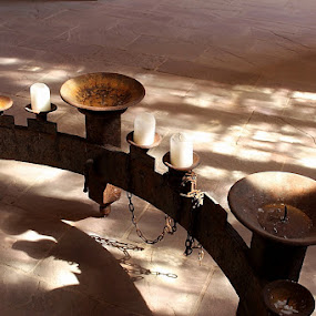 Antique candleholder by Birgit Vorfelder - Artistic Objects Antiques ( shadow play, candleholder, metal, monastery, candles, antique, light and shadow,  )