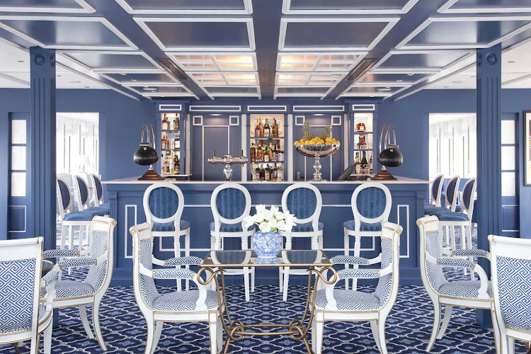 Enjoy a glass of fine wine in Uniworld's River Queen's classy bar and lounge while making your European river cruise.