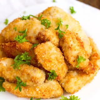 Parmesan Chicken Fingers with Garlic Cheese Sauce.