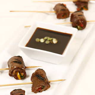 Grilled Beef Rolls with Scallion Soy Dipping Sauce.