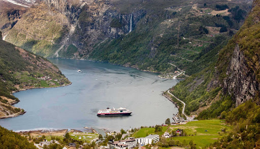Hurtigruten-Midnatsol-in-Geirangerfjord - Travel to the UNESCO-protected fjord Geirangerfjord in Norway on board Hurtigruten's ms Midnatsol and experience spectacular views of snow-covered mountain ranges, waterfalls and abandoned farms.