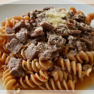 Pasta with Tomato Sauce and sliced Steak.