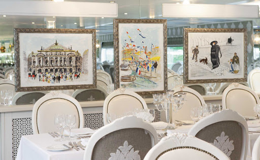 Uniworld-River-Beatrice-restaurant - The elegant restaurant aboard the River Beatrice offers guests an intimate atmosphere and inventive cuisine throughout their river cruise down the Danube River.