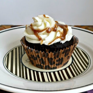 Dark Chocolate Cupcakes with Salted Caramel Filling and Vanilla Butter Cream Frosting and Caramel Drizzle..