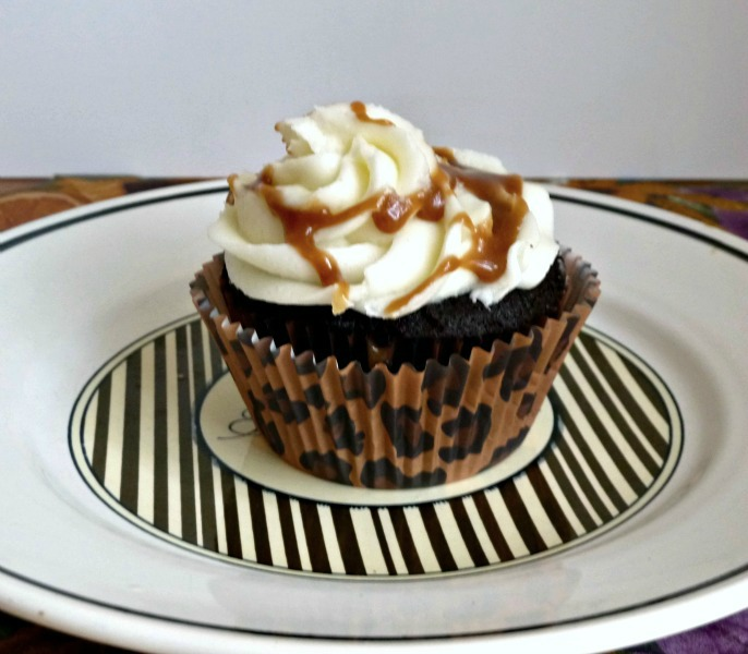 Dark Chocolate Cupcakes with Salted Caramel Filling and Vanilla Butter Cream Frosting and Caramel Drizzle. Recipe