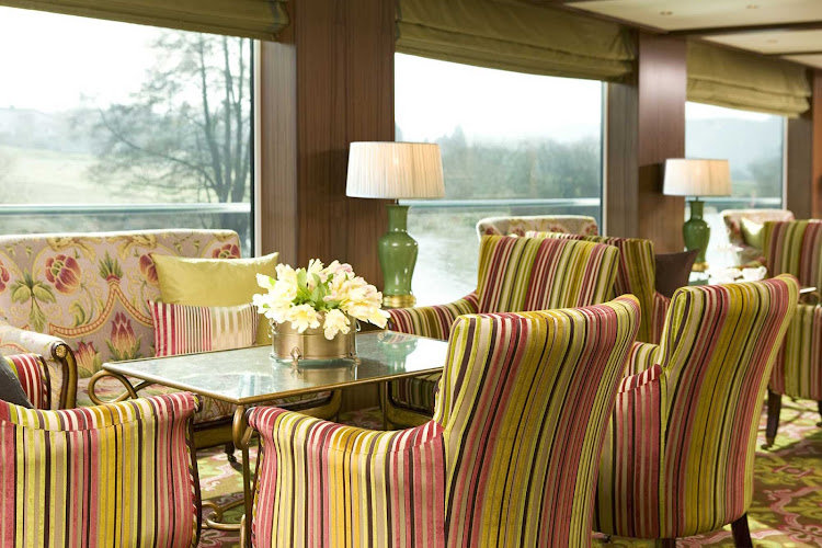Relax in the classically designed lounge of Uniworld's River Beatrice while you make your voyage along the Danube River.
