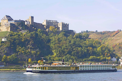 View historic battlements, monuments and lush scenery along the Rhine River during your luxury boutique cruise aboard Uniworld's River Queen.