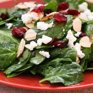 Thanksgiving Spinach Salad with Dried Cranberries, Almonds, and Goat Cheese.