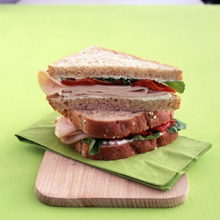 Turkey Sandwich with Ricotta, Red Peppers, and Arugula.