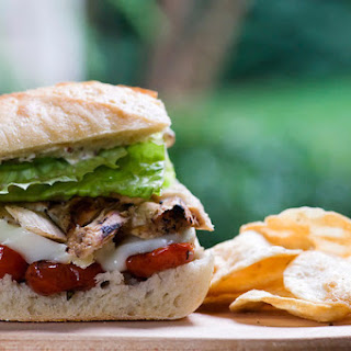 Chicken and Brie Sandwich with Roasted Cherry Tomatoes.
