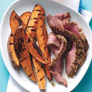 Grilled Flank Steak with Chimichurri and Sweet Potato Wedges.