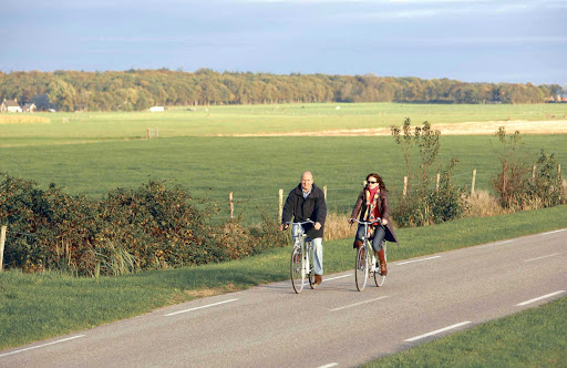 Bicycling through fields in the Netherlands.