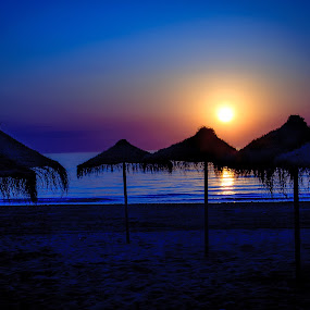 Blue Sunset by RaeLynn Petrovich - Landscapes Beaches ( blue, relax, sunset, umbrella, beach, spain )