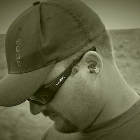 redneck rangemaster by Jim Lancaster - Black & White Portraits & People ( b&w, earplugs, bullet, man, shooting,  )