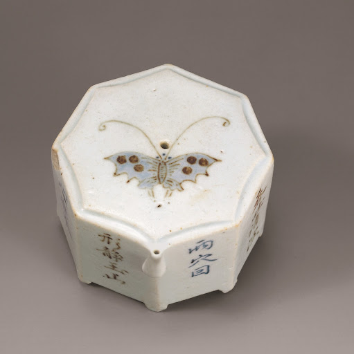 White Porcelain Octagonal Water Dropper with Butterfly Design and Inscription of a Poem in Underglaze Cobalt Blue and Iron