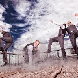 Fist of Fury by Nakean Wickliff - Wedding Groom ( skyline, holly, bench, wood, paricles, falling, digital, nakean photography, fantasy, break, sky, west seattle, seattle, ripples, suits, pier, clouds, alki, punch, smash, smoke, james, photos, nakean wickliff, fog, wedding, comic book )