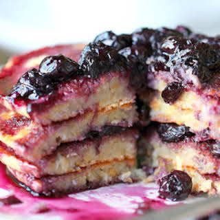 Lemon Scented Polenta Pancakes with Blueberry Thyme Syrup.