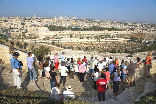 Visitors take in the sweeping view from Mount Zion, Israel.