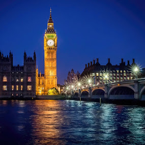 Time to Reflect by Jan Murphy - Buildings & Architecture Public & Historical ( water, star lights, thames, clock, buildings, reflections, windows, bridge, big ben, glow, houses of parliament, lamp posts, , city at night, street at night, park at night, nightlife, night life, nighttime in the city )