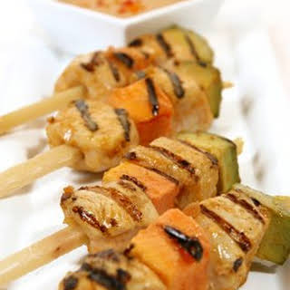 Tropical Chicken on Sugarcane Skewers with Peanut-Plantain Dipping Sauce.