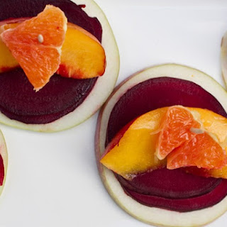 Energizing Stacked Beet, Apple, and Orange Salad.