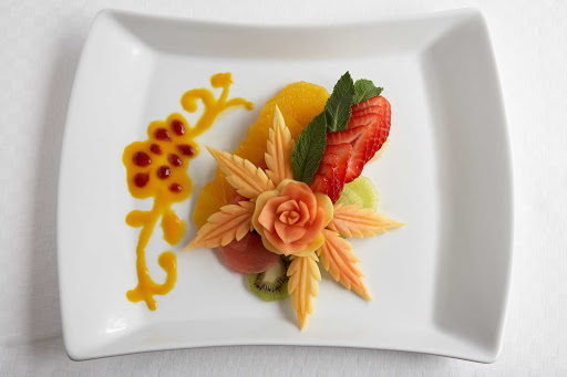 Murano_fruit_salad - A delicate fruit salad presented in Celebrity Cruises's Murano dining room.