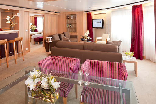 Seabourn_Odyssey_Sojourn_Quest_Signature_Suite - The Signature Suite on Seabourn Sojourn lets you spread out. It has a dining area that fits six people, a private bedroom and bathroom with a large whirlpool tub, a stocked pantry and wet bar, and complimentary wi-fi.