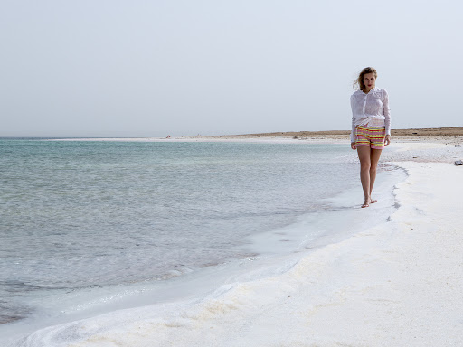 Walking along the shore of the Dead Sea.