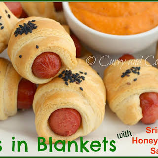 Pigs in Blankets with Sriracha Honey Mustard Sauce.
