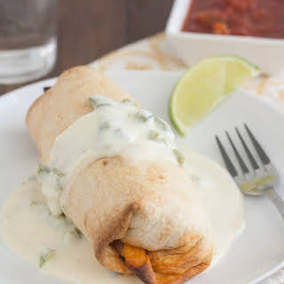 Slow Cooker Smoky Shredded Chipotle Beef Burritos with Poblano Sauce.