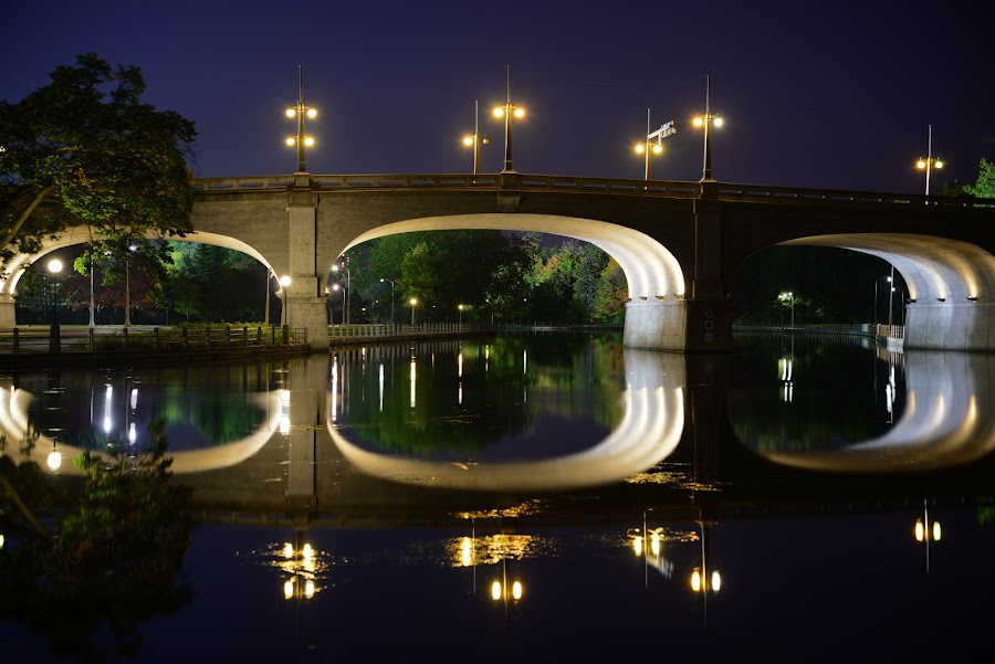 Early Fall on the Rideau Canal by Scott Thiel - Buildings & Architecture Bridges & Suspended Structures ( glebe, reflection, canada, bank st, ottawa, ontario, night, long exposure, rideau canal, bridge, canal, , mood factory, color, lighting, moods, colorful, light, bulbs, mood-lites, city at night, street at night, park at night, nightlife, night life, nighttime in the city )