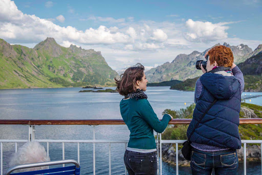 Hurtigruten-Midnatsol-in-Nordland - Capture the dramatic scenery of Nordland from the deck of Hurtigruten's Midnatsol during your summer journey along  Norway's scenic coastline.