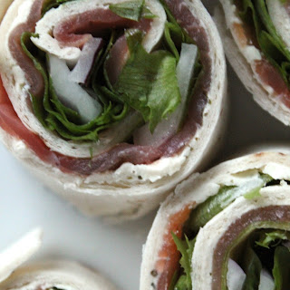 Smoked Salmon Wraps With Dill Cream Cheese, Lettuce And Red Onion