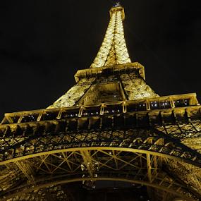 Tower At Night by Megan Richardson - Buildings & Architecture Public & Historical ( lights, eiffel tower, paris, landmark, france, night, historical, travel )